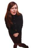 Cystite abdominale de vessie de douleur et de diarrhée de femme malade de fille blême Image stock
