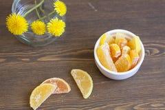 Cytrus marmoladowy i dandelions Zdjęcie Royalty Free