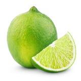 Cytrusa wapna owoc z plasterkiem na bielu Zdjęcia Stock