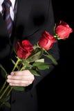 człowiek czerwone róże fotografia stock