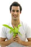 człowiek się mała roślin fotografia stock