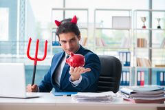 Czarci gniewny biznesmen w biurze Zdjęcia Royalty Free