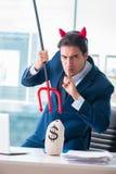 Czarci gniewny biznesmen w biurze Obraz Stock