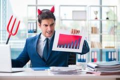 Czarci gniewny biznesmen w biurze Fotografia Stock
