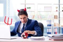 Czarci gniewny biznesmen w biurze Obraz Royalty Free