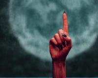 Czarci ręki wskazywać oddolny Zdjęcie Stock
