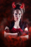 Czarcia dziewczyna z pożarniczym skutkiem Fotografia Royalty Free