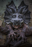 czarcia postać, brązowa rzeźba z demonic gargulecami i monste, Zdjęcie Stock