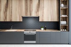 Czarna ceglana kuchnia, drewniani countertops ilustracji
