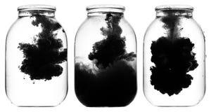 Czarna farba wiruje w wodzie Obraz Stock