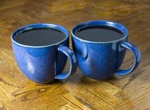 Czarna kawa w polki kropki kubku Obrazy Royalty Free