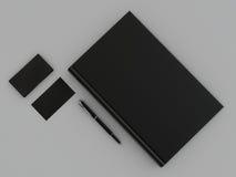 Czarna książka i wizytówka Obrazy Stock