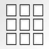 Czarna pionowo fotografii rama na szarości ścianie z realistycznymi cieniami Zdjęcia Stock