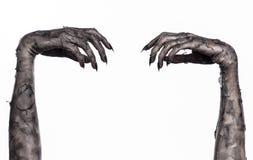 Czarna ręka śmierć chodzący nieboszczyk, żywego trupu temat, Halloween temat, żywy trup ręki, biały tło, mamuś ręki Zdjęcia Royalty Free