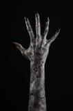 Czarna ręka śmierć chodzący nieboszczyk, żywego trupu temat, Halloween temat, żywy trup ręki, czarny tło, mamuś ręki zdjęcia royalty free