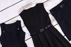 Czarna szkolna odzież dla dziewczyn Obrazy Royalty Free