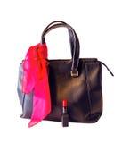 Czarna torba, różowy szalik i czerwieni pomadka odizolowywająca na bielu, Fotografia Stock