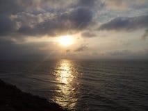 Czarne denne chmury i wschód słońca Obrazy Stock