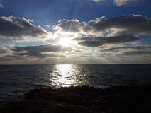 Czarne denne chmury i wschód słońca Fotografia Royalty Free