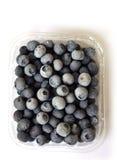 Czarne jagody w klingerytu pakować (odgórny widok) Obrazy Stock