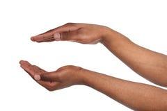 Czarne męskie ręki utrzymuje w cupped kształcie, wycinanka Obrazy Royalty Free