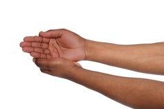 Czarne męskie ręki utrzymuje w cupped kształcie, wycinanka Fotografia Stock