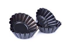 Czarne mini tarta cyny na białym tle Fotografia Royalty Free