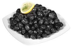 Czarne oliwki na talerzu Zdjęcie Stock