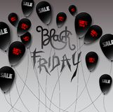 Czarne piłki robić w papierze projektują z czerwoną i białą inskrypcją: zdjęcia stock