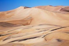 Czarne piasek granie przy Wielkim piasek diun Pres i parkiem narodowym Zdjęcie Royalty Free
