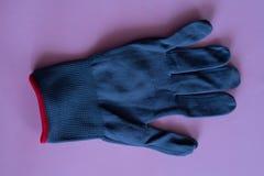 Czarne prac rękawiczki na różowym tle kombinezony i mundury Ręki ochrona zdjęcia stock
