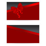 Czarne prezent karty z czerwonymi faborkami Fotografia Stock
