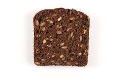 Czarnego chleba plasterek odizolowywający Zdjęcie Stock