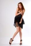 czarnej dziewczyny togami krótka zdjęcie stock