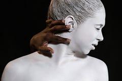 Czarnej ręki zasięg dla ucho zdjęcie royalty free