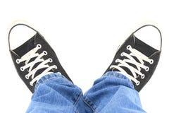 Czarni brezentowi sneakers, odgórny widok fotografia stock