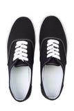 Czarni brezentowi sneakers, odgórny widok obrazy stock