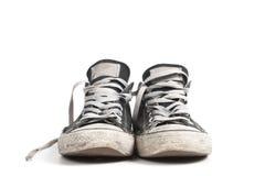 Czarni brezentowi sneakers, odizolowywający Zdjęcia Royalty Free