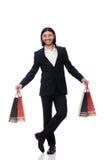 Czarni kostiumu mężczyzna mienia plastikowi worki odizolowywający na bielu obraz royalty free