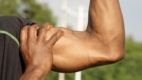 Czarni Męscy mięśnie I atleta zdjęcie stock