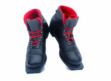 Czarni narciarscy buty na białym tle. Obrazy Royalty Free