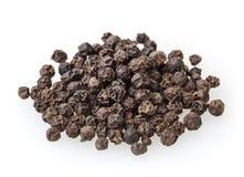 Czarni peppercorns odizolowywający na bielu Obraz Royalty Free