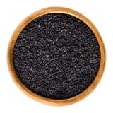 Czarni sezamowi ziarna, także benniseed, w drewnianym pucharze Obraz Stock