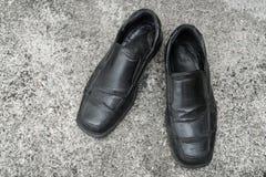 Czarni starzy buty Obrazy Royalty Free