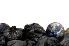 Czarni torba na śmiecie i ziemia Fotografia Stock