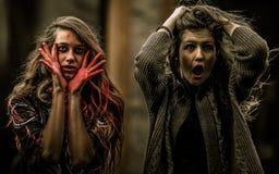 czarni włosy Halloween długiego spojrzenia makeup dyniowy seksowny strzał ja target885_0_ czarownicy kobieta Obrazy Stock