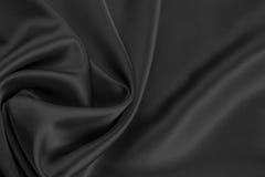 Czarny atłas lub jedwabnicza tkanina Fotografia Stock