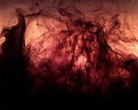 Czarny atrament tworzy płomienie w wodzie Fotografia Stock