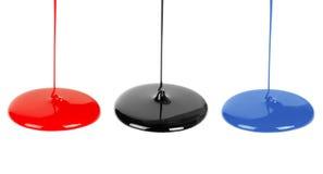 czarny błękitny ciecz maluje czerwień obraz stock