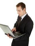 czarny biznesowi laptopu mężczyzna kostiumu potomstwa obraz royalty free